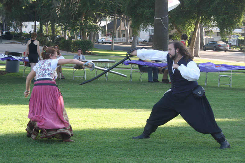 Members demonstrating fighting at activities fair